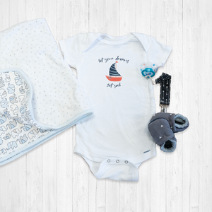 Let Your Dreams Set Sail Onesie®