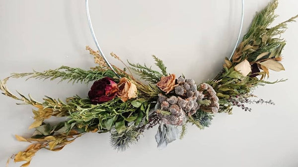 Dried wedding bouquet turned into a wreath.The perfect wedding memory keepsake.