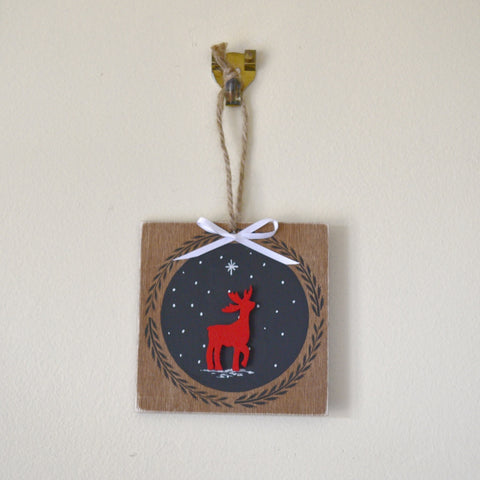 Hanging reindeer plaque