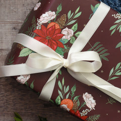 Poinsettia and pine cones gift wrap