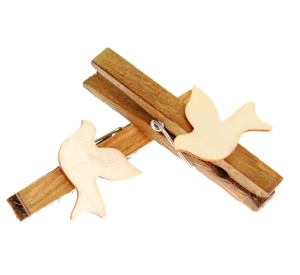 Pack of five wooden pegs with white doves
