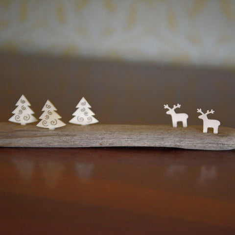 Driftwood with three trees and two reindeers