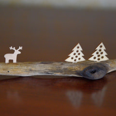 Driftwood with two trees and one reindeer