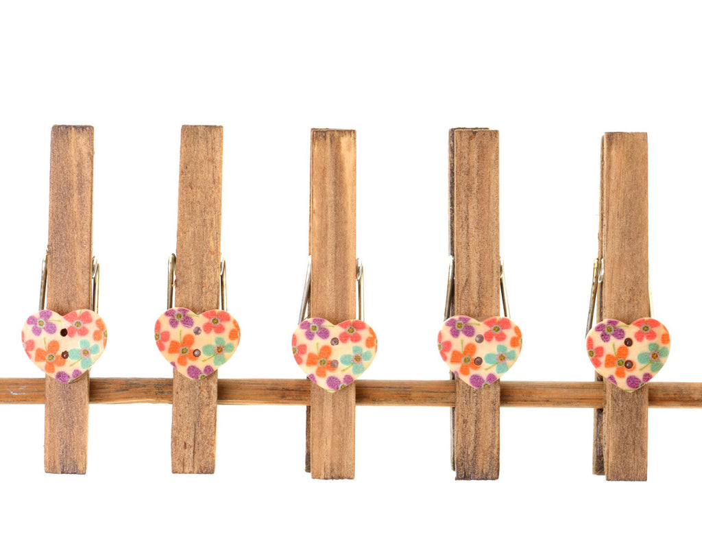 Pack of five wooden pegs with buttons