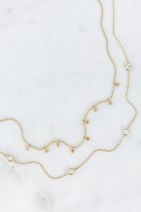Gold Dangle Triple Strand Necklace