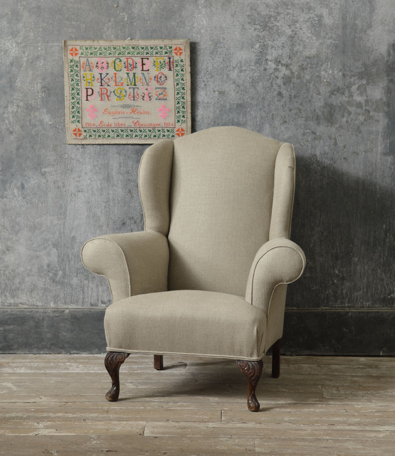 Queen Anne style winged country armchair.