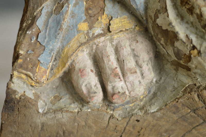 EARLY CARVING OF A SAINTS FOOT