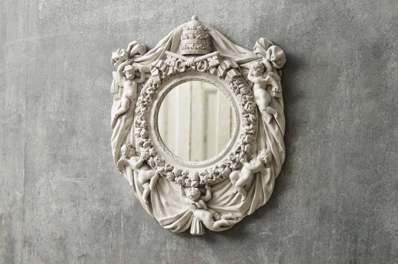 An Italian mirror moulded from a Vatican window.