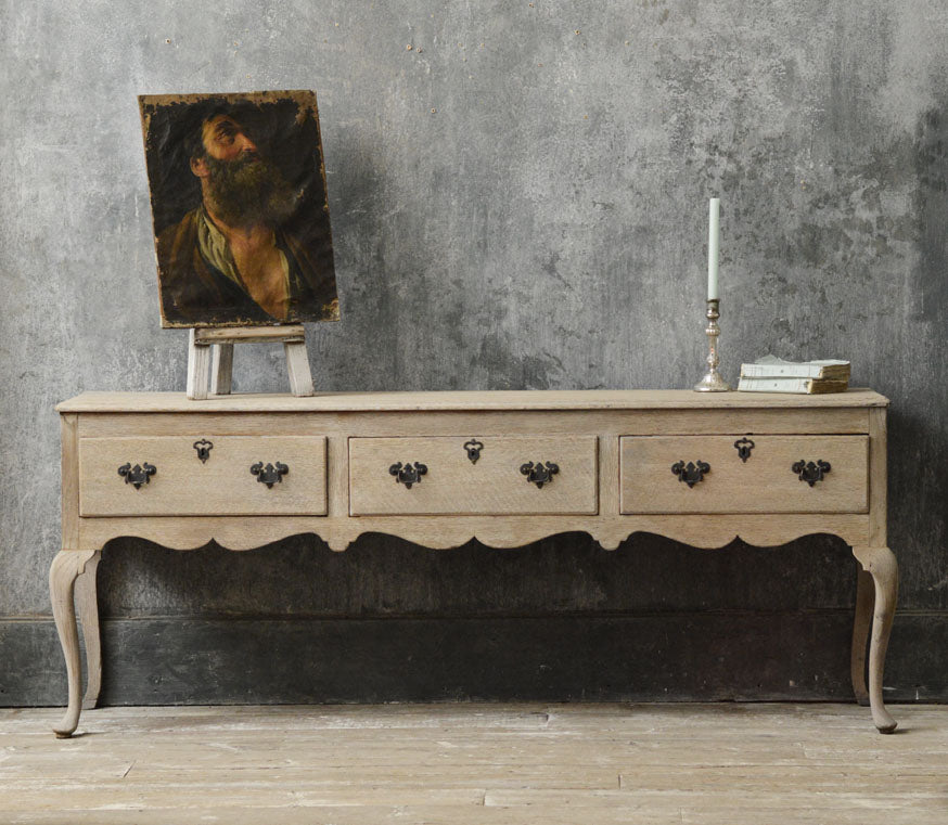 English 18th Century bleached oak dresser base.