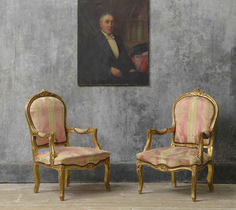 A pair of Louis Philippe gilt chairs