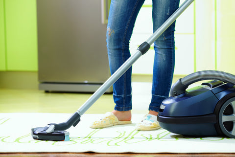 How Often Should I Vacuum My Dorm? woman vacuuming floor
