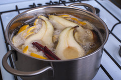 How To Naturally Make Your Home Smell Like The Holidays pot simmering fruits and spices
