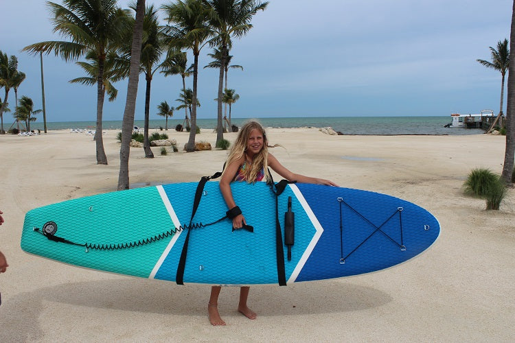 A girl carrying a Zupapa Inflatable SUP
