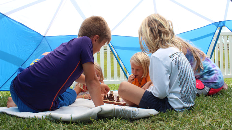 Kids playing chess inside the zupapa dome climber