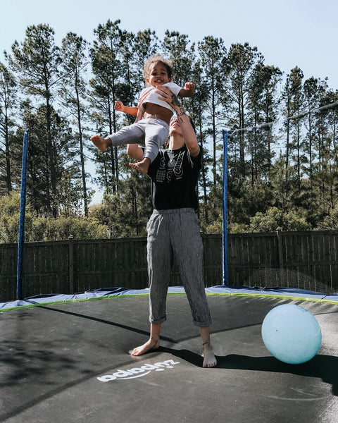 Mom and baby having fun on the Zupapa trampoline