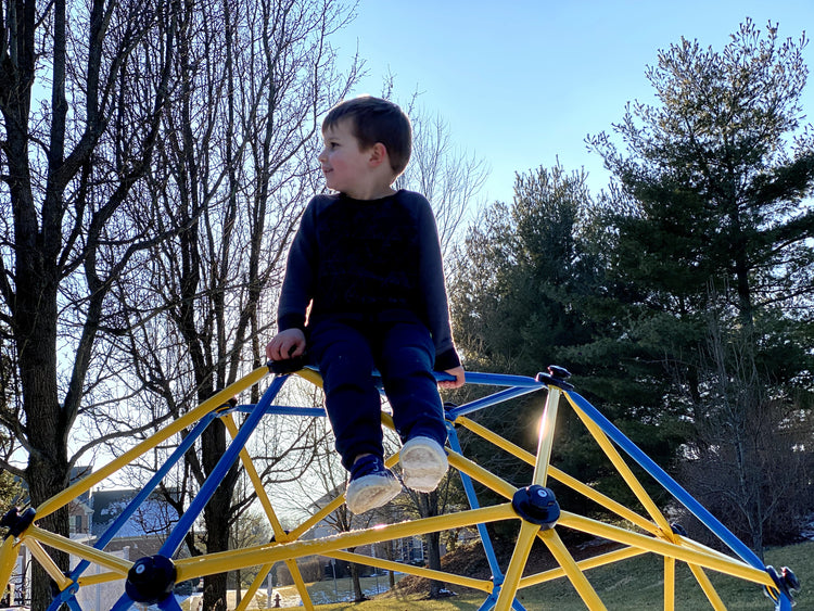 a boy on a Zupapa dome climber in a sunny winter day