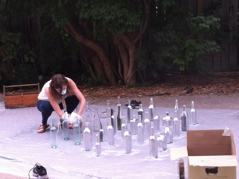 DIY centerpieces being spray painted for wedding.