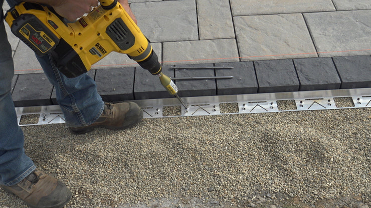 Dense Grade Base Solution for Hardscape and Landscape Edging installs landscape spikes at a 60 degree angle for a no lift solution.  Made of Aluminum Steel in 8' lengths to prevent uplift.