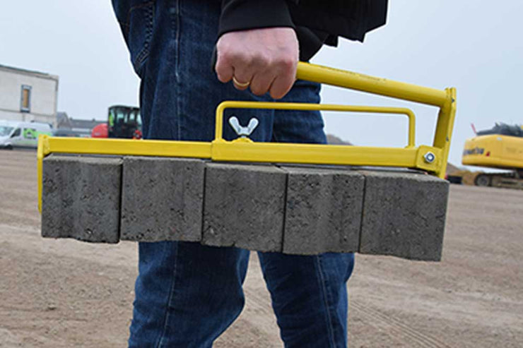 Hand Tong is a block clamp that picks up several pavers at once for easy transportation