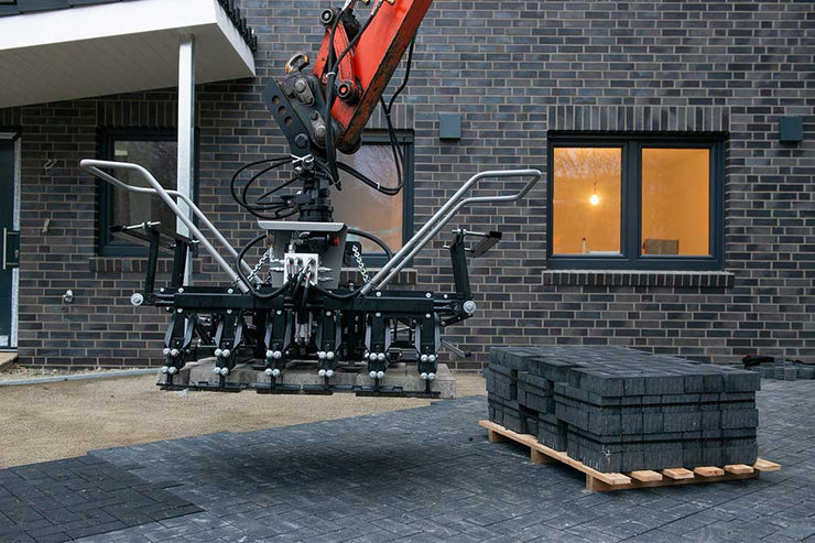 Multi6 Head attaches to an excavator to lift multi pavers at one time for hardscaping