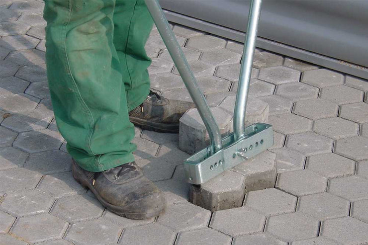 Optimas Paver Puller sold by Pave Tool is an extractor that removes pavers without bending over and with ease