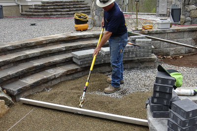 Using the Quick-E-Screeder Package to screed out #9 stone or pea stone for a permeable application. Using the 6' blade. The Quick-E-Screeder Package comes with a 3', 4.5' and 6' blade along with the interchangeable handle