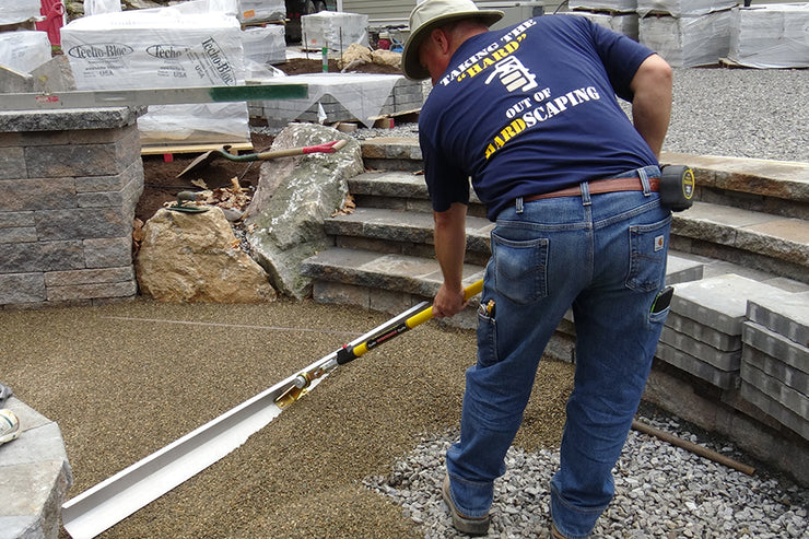 Using the Quick-E-Screeder Package to screed out #9 stone or pea stone for a permeable application. Using the 6' blade. The Quick-E-Screeder Package comes with a 3', 4.5' and 6' blade along with the interchangeable handle.