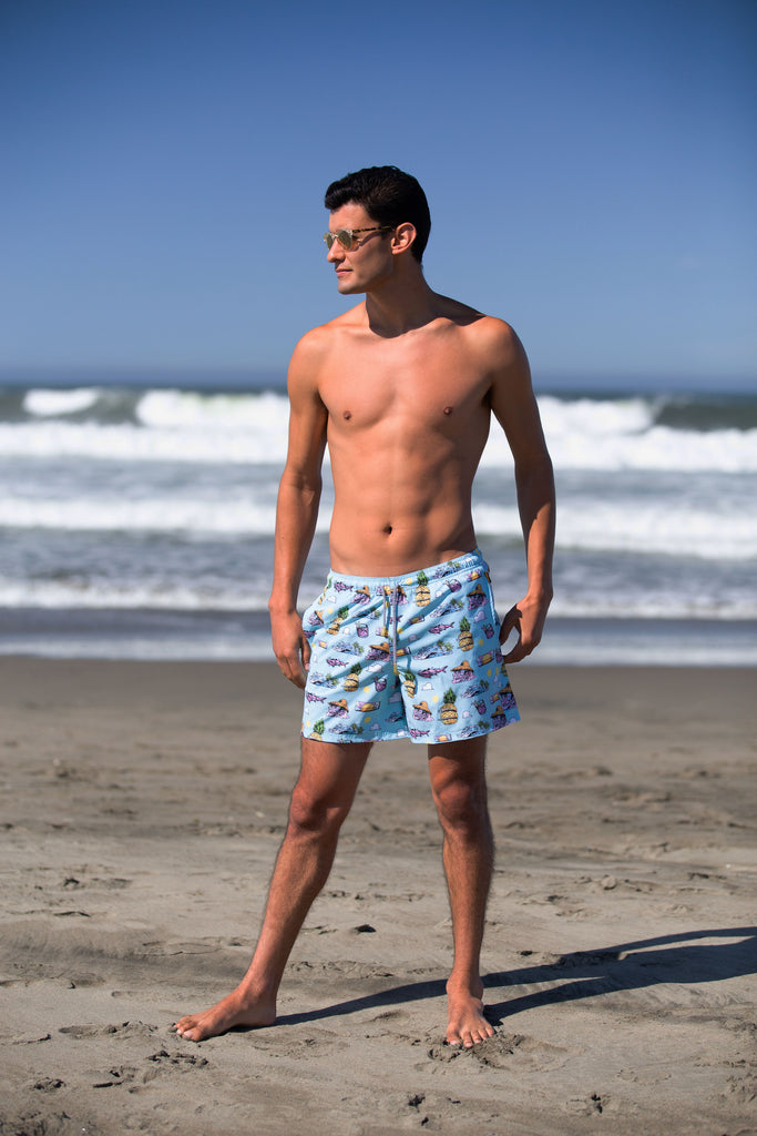 Enrique Montano wearing tropical swim trunk in the beach