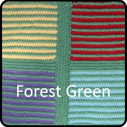 Easy knitting woolen blanket kit forest green colorway closeup image.