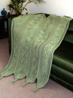 Load image into Gallery viewer, Unique knitted blanket with diamond cable and bobble pattern draped over satin covered chair.