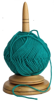 Hand made turned timber Yarn Butler. Finished with clear laquer and loaded with a ball of aqua coloured wool.