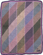 Load image into Gallery viewer, Hand-knitted woolen blanket, knitted in panels with diagonal rows. Complete blanket has both diagonal and vertical intermixed pastel colours.