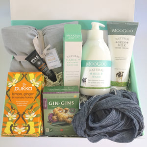 Soothing heat pillow by Tonic Australia, Neck scarf or slippers, Nausea relieving ginger chews by Gin gins, Organic therapeutic tea: Pukka - Lemon, ginger & manuka honey, Milk (body) wash for sensitive skin by Moo goo, Skin udder body cream by Moo goo, Anti bacterial hand moisturiser by Moo goo, Soothing paw paw balm for lips by Pure by phytocare in a gift box by Wishing You Well.