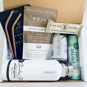 Eco friendly gift box/care package including Ever Eco stainless steel drink bottle & straws, Naked Paleo snack bar, Koja pancake mix, Gold Grind turmeric hot choc and smoothie bombs.