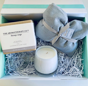 a warm hug care package / heat pillow / The Aromatherapy company therapy range candle / Lavender