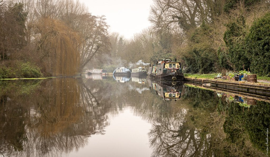 Canal with boats in mist