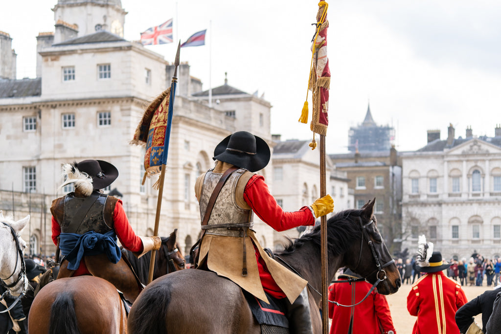 Mounted members of the English Civil War Society in historical costume. They lead the parade to commemorate the execution of King Charles I.