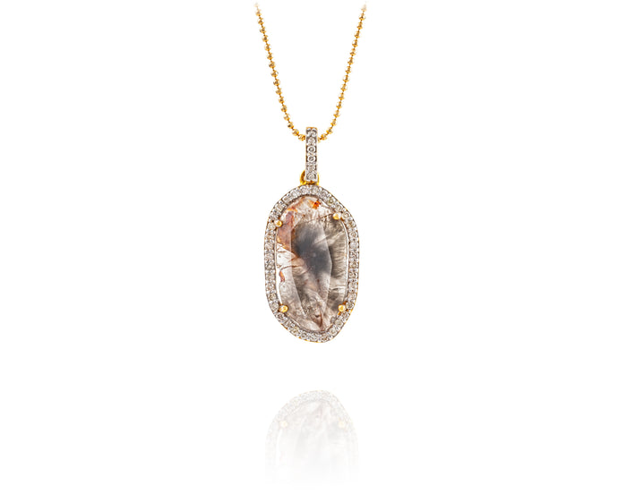 1.9ct Rosecut center diamond surrounded by .3ct of pavé diamonds, set on an 18kt gold pendant, and hung on a 14kt gold chain.