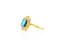 .82ct of episodic white diamonds surround a beautiful blue turquoise on a 14kt gold band. Sizable on request.