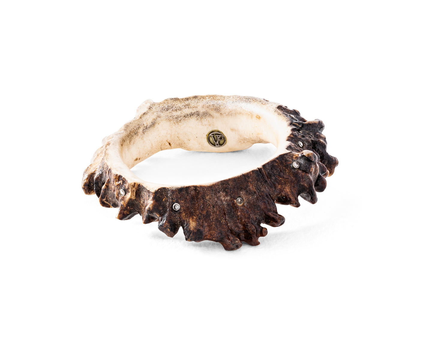 Genuine moose antler bangle, speckled with round diamonds and a VP insignia.  No two bangles are exactly alike.