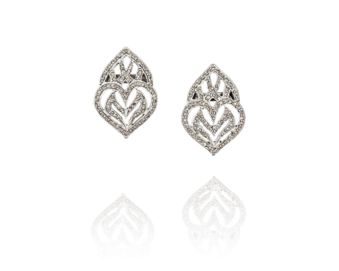Diamond encrusted, hand-made organically shaped sterling silver post earrings. Approximately .875in/2.2cm tall