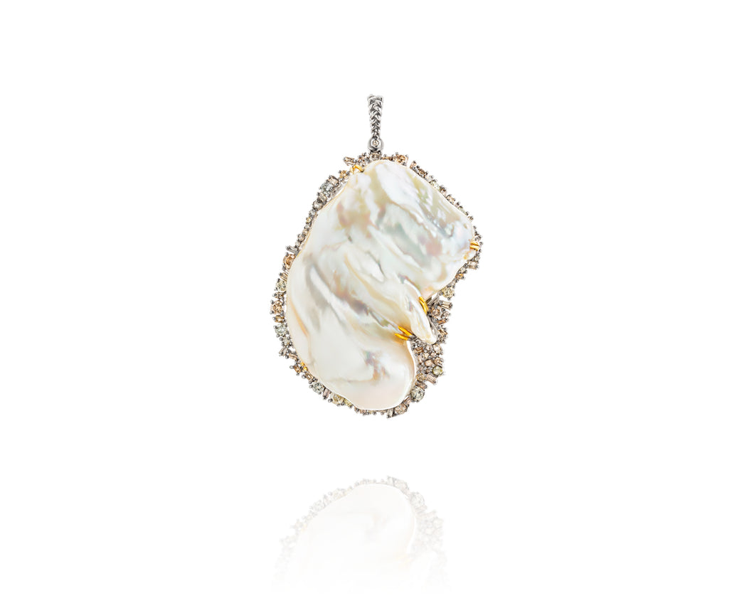 An enormous, singular baroque freshwater pearl accented by 5.11ct of episodic baguette and round diamonds set in fine sterling silver. One-of-a-kind, absolutely unique, and an incredible statement piece.