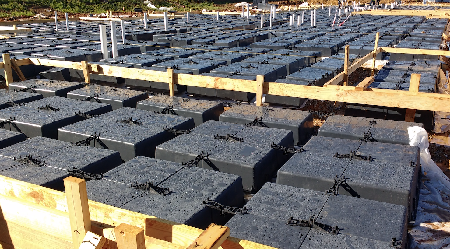 multifamily construction with wafflemat provides the cheapest house foundation