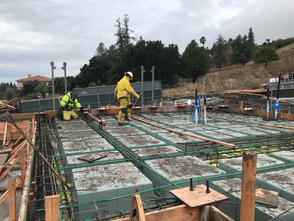 RJ Doston contractors enjoy the benifits and ease of use of the Wafflemat Foundation System in construction of a large multi-family housing project on expansive soils.