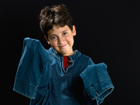 Boy wearing jacket with sleeves too long