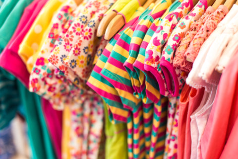 Baby clothing hanging in the closet