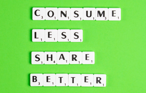 Consume less, share more text on green background
