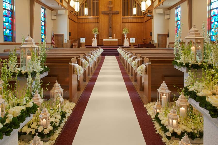Traditional wedding aisle floral design