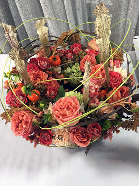 Fall floral arrangements with natural decorative accessories