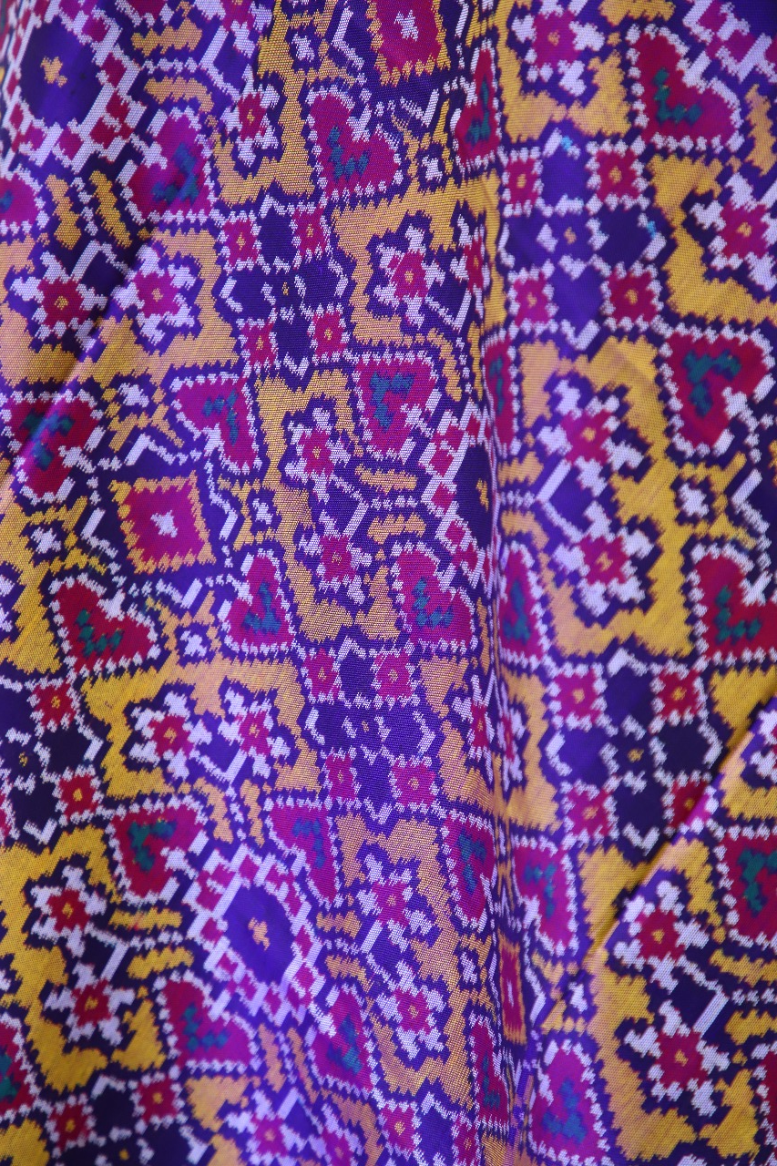 Semi double ikat dupatta in Yellow and Purple colour with traditional navratna and manekchowk design